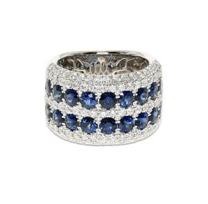 A wide band of white gold with rows of sapphires and diamonds