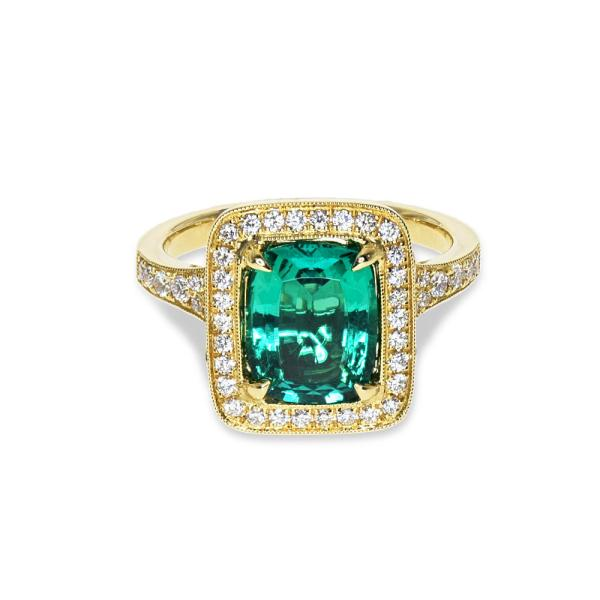 A gold ring featuring emerald and diamonds