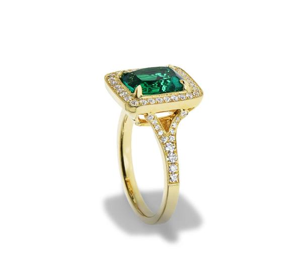 Gold Ring With Large Emerald And Diamonds