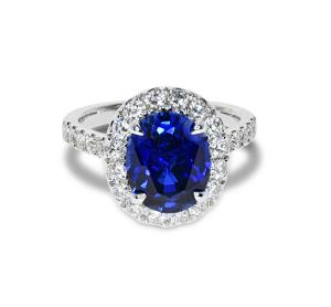 A white gold ring with sapphire and diamonds