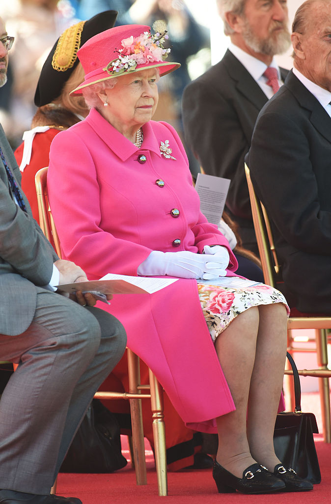 WINDSOR, ENGLAND - APRIL 20: Queen Elizabeth II watches a performance of locals acts to open the Alexandra Gardens Bandstand as part of her 90th Birthday celebrations In Windsor on April 20, 2016 in Windsor, England. (Photo by Stuart C. Wilson/Getty Images)