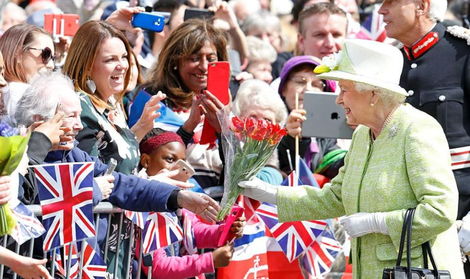 WINDSOR, UNITED KINGDOM - APRIL 21: (EMBARGOED FOR PUBLICATION IN UK NEWSPAPERS UNTIL 48 HOURS AFTER CREATE DATE AND TIME) Queen Elizabeth II meets the public during her 90th Birthday Walkabout on April 21, 2016 in Windsor, England. Today is Queen Elizabeth II's 90th Birthday. (Photo by Max Mumby/Indigo/Getty Images)