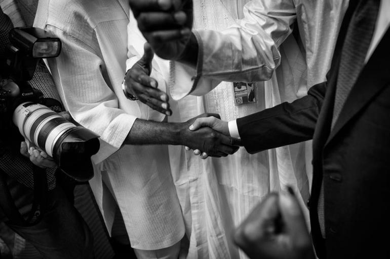 Shaking hands at the Nigerian presidential palace.