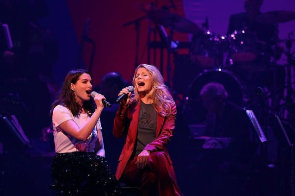 NEW YORK, NY - OCTOBER 17: Anne Hathaway (L) and Kelli O'Hara perform during the Hillary Victory Fund - Stronger Together concert at St. James Theatre on October 17, 2016 in New York City. Broadway stars and celebrities performed during a fundraising concert for the Hillary Clinton campaign. (Photo by Justin Sullivan/Getty Images)