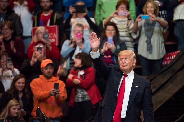 President-elect Donald Trump acknowledges the crowd after speaking at U.S. Bank Arena on December 1, 2016 in Cincinnati, Ohio. Trump took time off from selecting the cabinet for his incoming administration to celebrate his victory in the general election. (Photo by Ty Wright/Getty Images)
