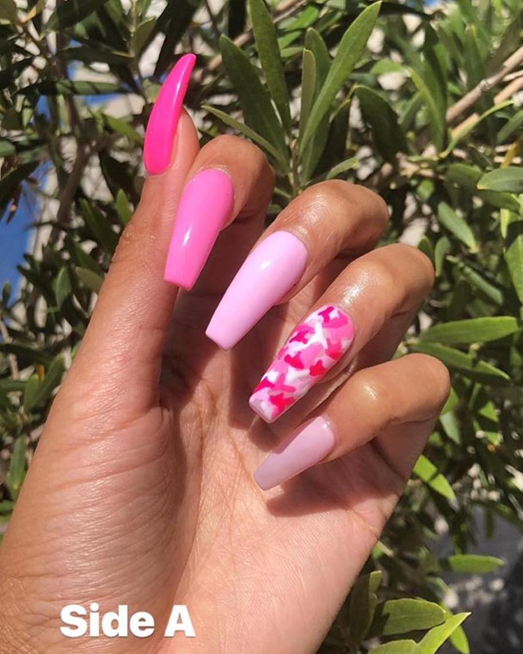 The design done by Keisha Sheree of LaquéNailBar, features a plain coat  with varying shades of the same colour on all but one nail. - Fact: This Pretty Nail Design Is Perfect For Summer BN Style