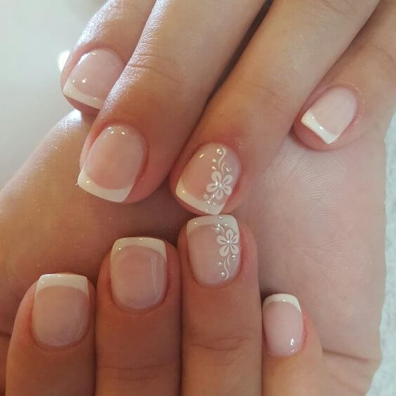 Nails With Traditional White French Tip And Fl Design On Ring Fingernail