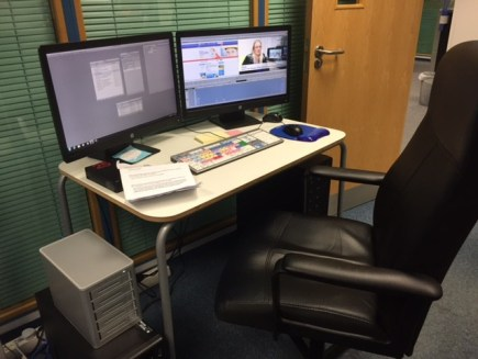 The Avid non-linear editing system set up on a table.