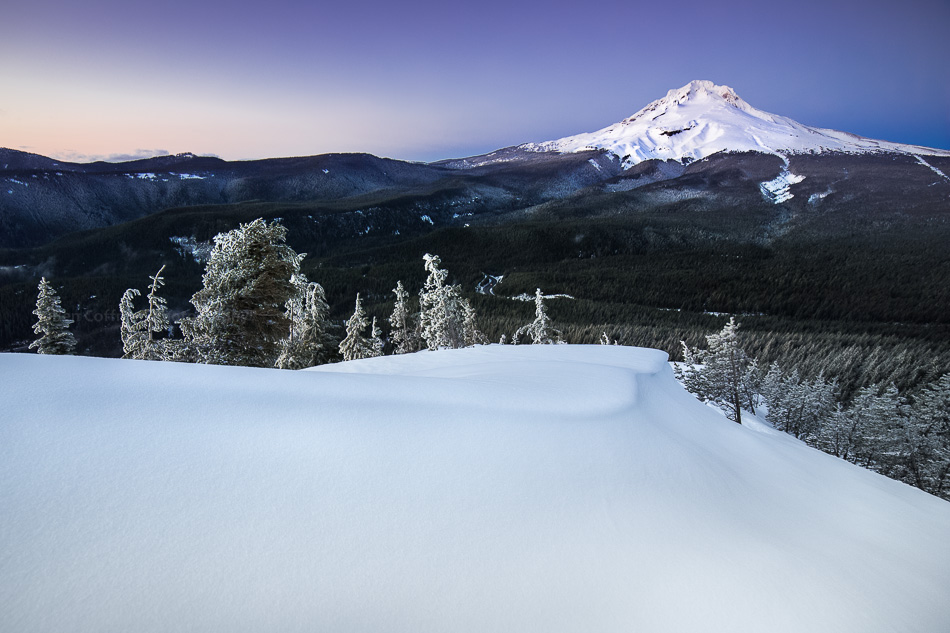 Mt Hood in the snow, at sunset.