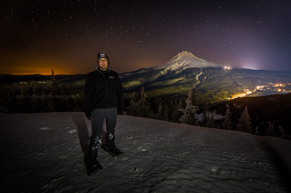 I pose for a photo at night with Mt Hood in the background.
