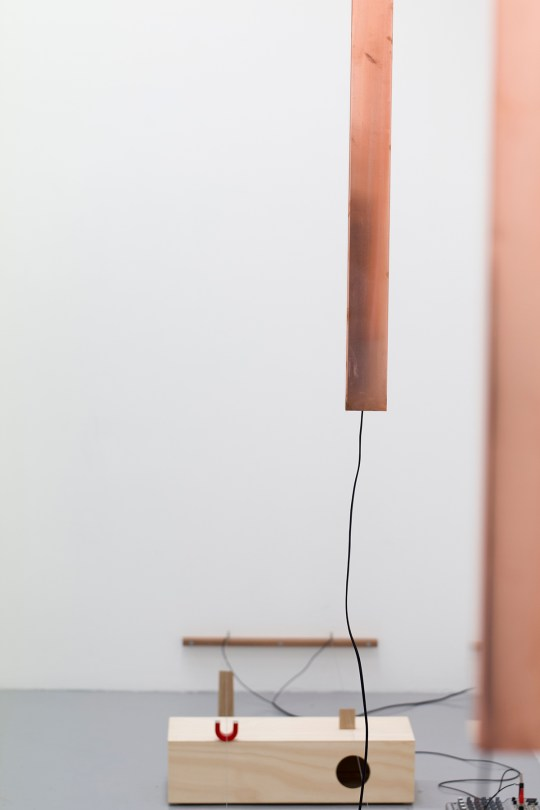 Paul Greedy, Om, 2016, wood, copper, piano wire, magnets, electronics, digital sine tones. Installation view.
