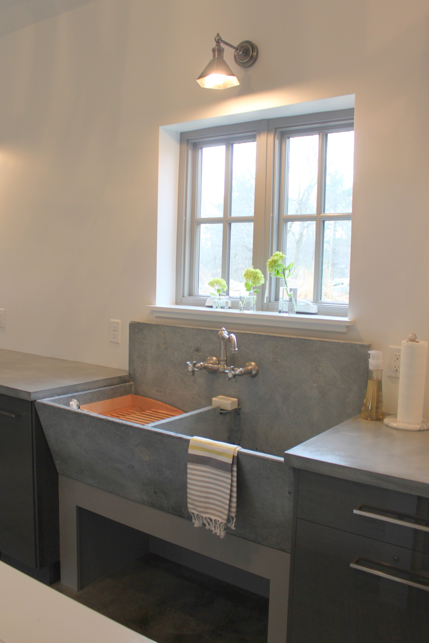 a vintage concrete laundry sink in the laundry room beneath my heart