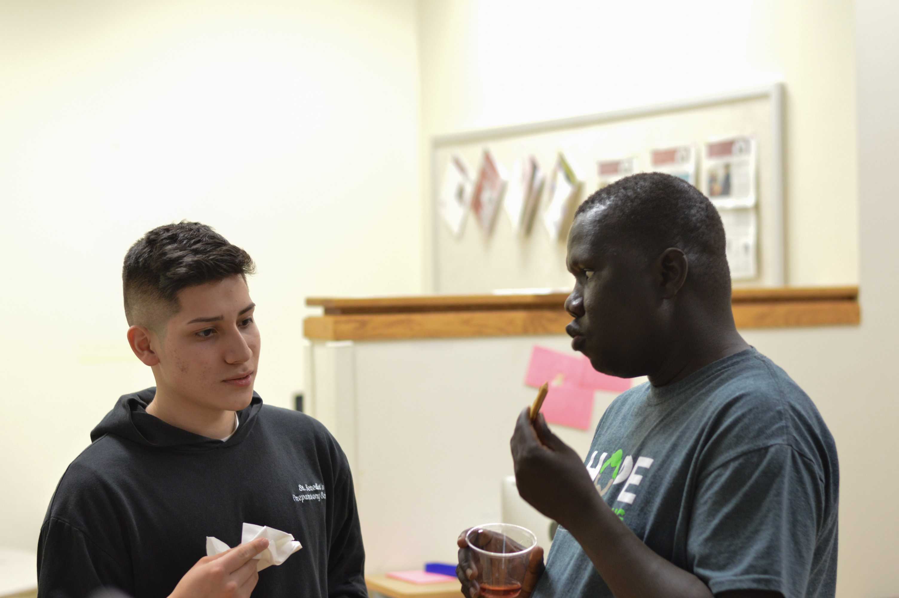 Gabriel Bol Dang talks with senior Antonio Melgar
