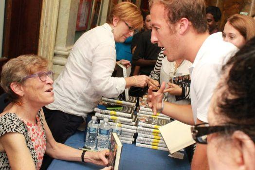 Benedictine volunteer Chris Heitzig gets his book signed.