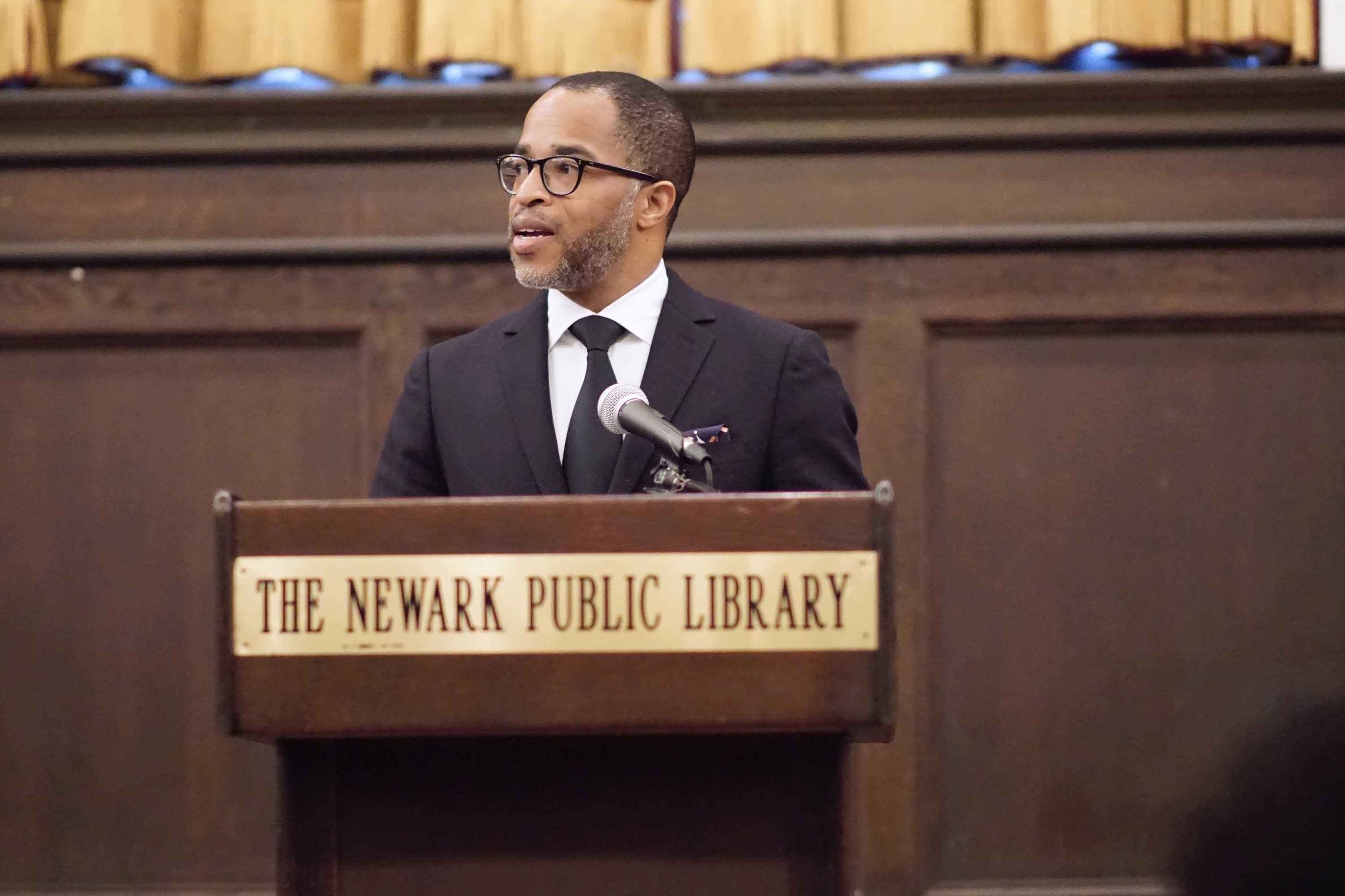 Jonathan Capehart '85 speaks to the audience of students,  community members, and patrons assembled at the Newark Public Library on Saturday, Feb. 6.