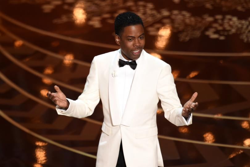 Chris Rock hosts the 88th Academy Awards on Feb. 28, 2016, in Hollywood. The Oscars broadcast did not see a significant decline in African-American viewers from 2015.