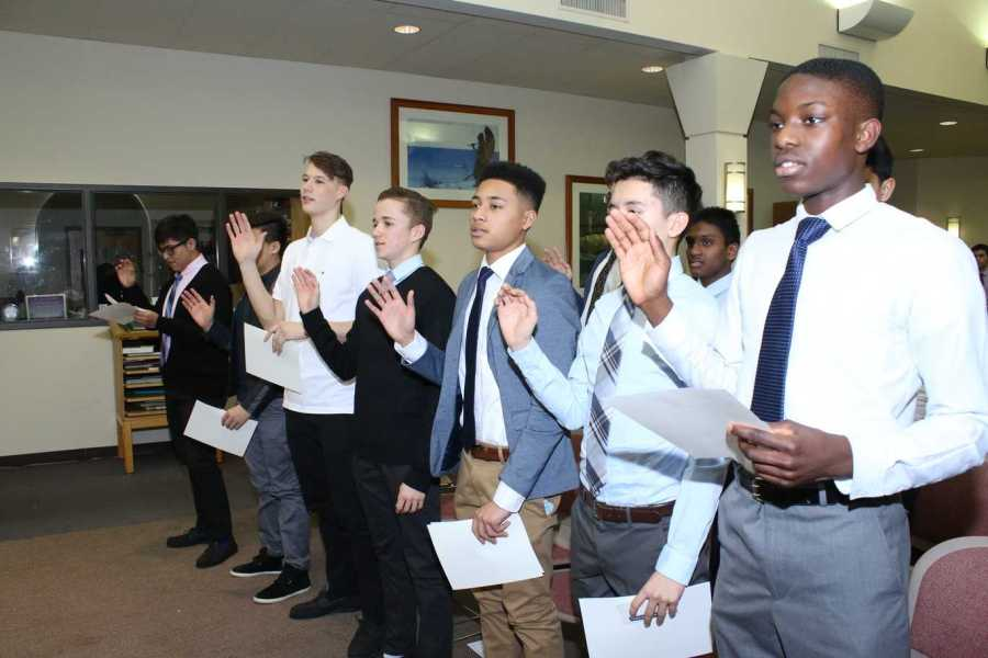 Eleven inductees make NHS pledge.