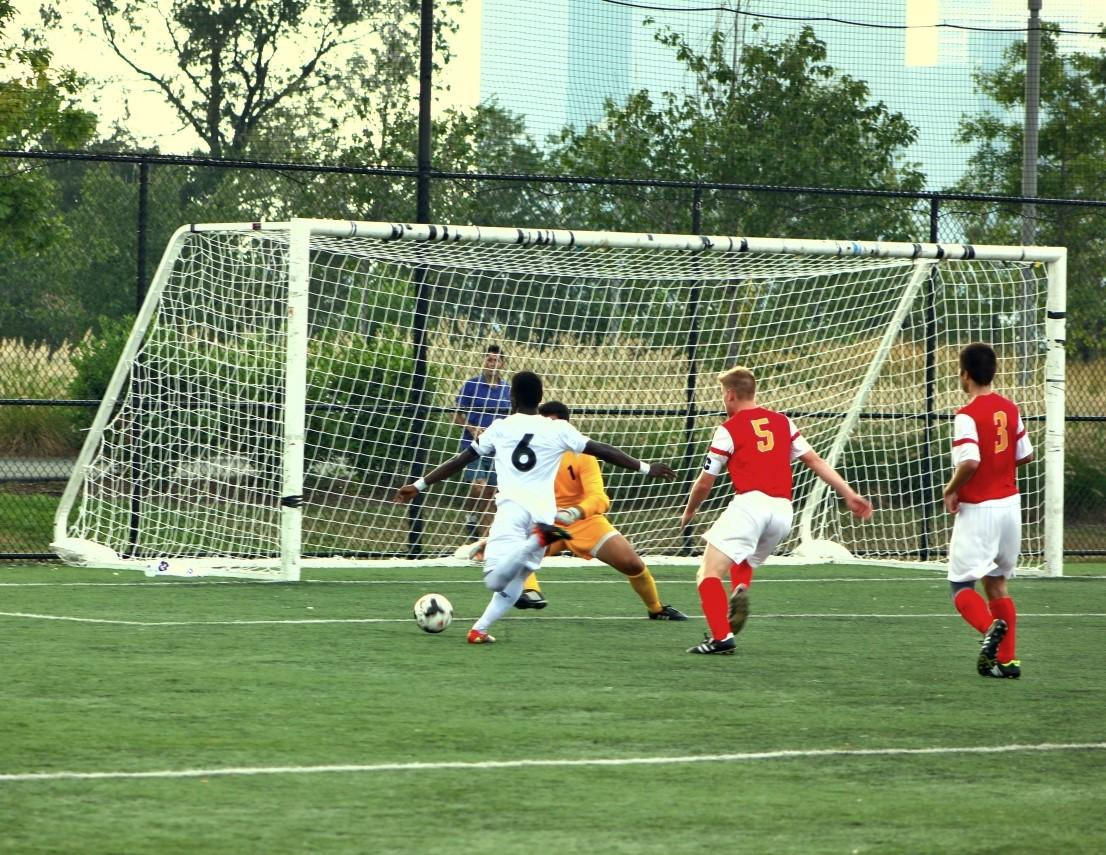 Senior Mickey George attempts a goal at the Chaminade game September 10. Benedict's won 3-1.