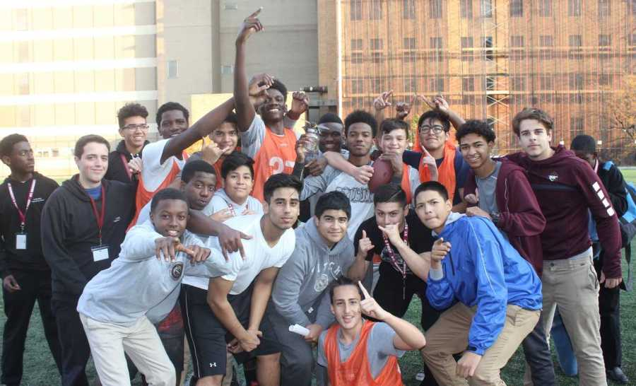 Father Philip Hoover's group members celebrating after obtaining the Group Game Championship in football.