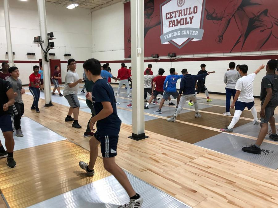 St. Benedict's Varsity Fencing Team practices footwork  in the new Cetrulo Family Fencing Center to strengthen offensive and defensive moves.