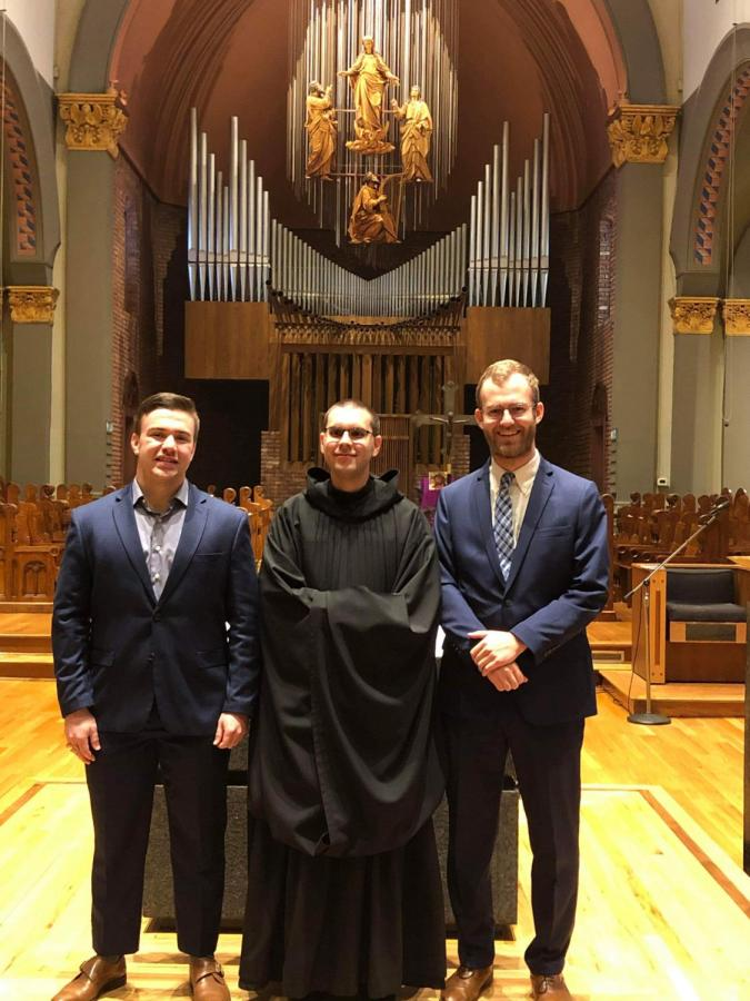 (From left) Volunteer Jack Barsody joins Br. Asiel Rodriguez, and Volunteer James Mello at the conclusion of the service.