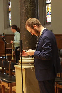 The man behind the YouTube video: Benedictine Volunteer James Mello films the Solemn Profession.