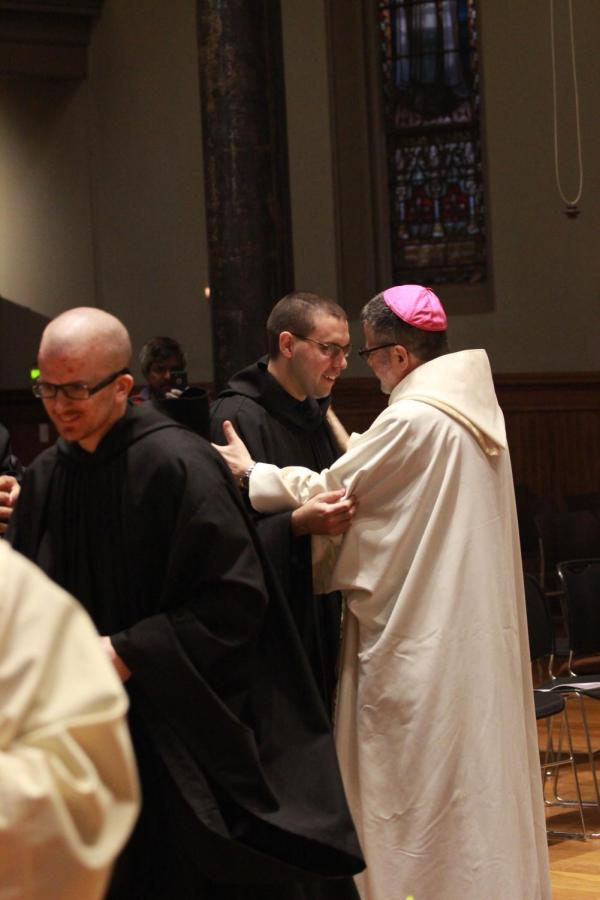 Br. Asiel is welcomed to the community by Auxiliary Bishop-elect Elias Lorenzo, O.S.B.