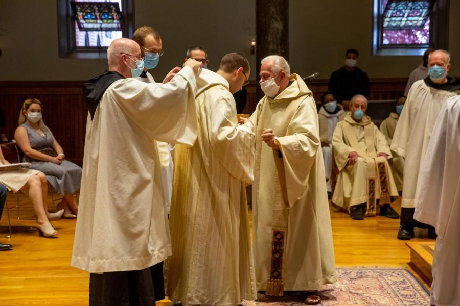 The monks of Newark Abbey assist Br. Asiel with new vestments.