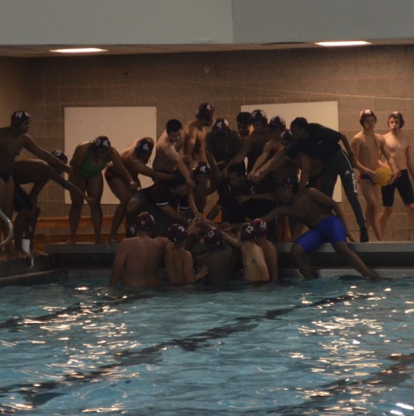 The SBP Water Polo Team breaks out the huddle Saturday.