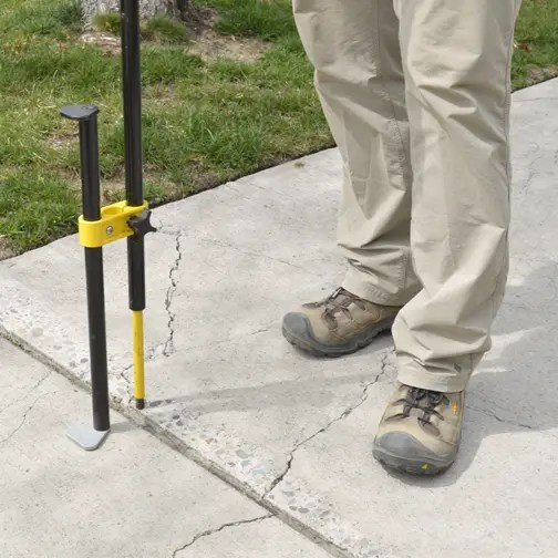 the digital height measuring device measures a vertical transition between sidewalk panels
