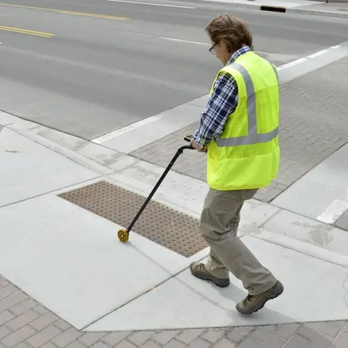 the digital measuring wheel measures the width of a curb ramp
