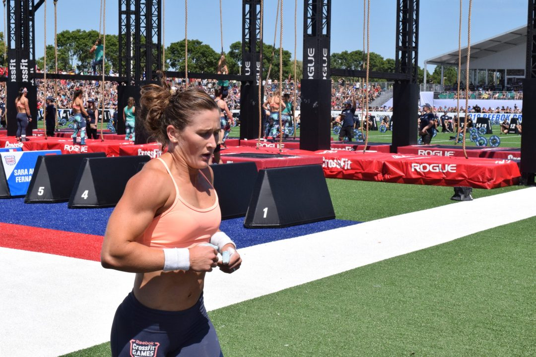 Tia-Clair Toomey completes a run between sets of legless rope climbs at the 2019 CrossFit Games