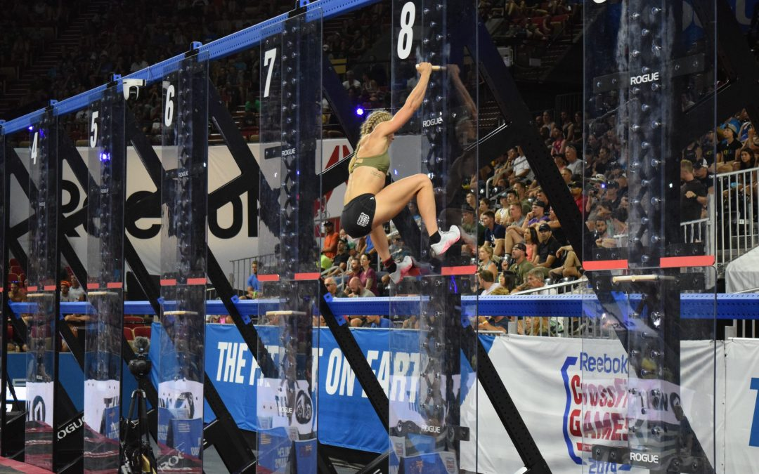 Thuri Helgadottir climbs the pegboards in the coliseum during the 2019 CrossFit Games.