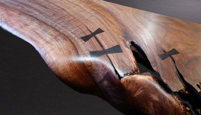 hand cut bowtie inlay in live edge walnut slab as a floating shelf