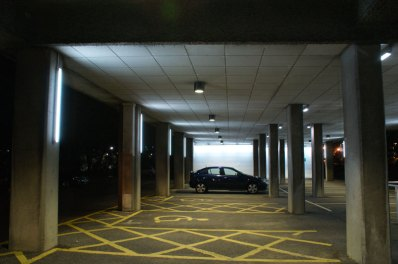 An image of the car park showing a wash of light to the back walls, and illumination to the columns.