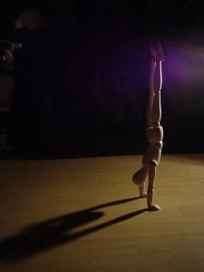 Figure doing a handstand