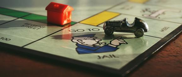 monopoly board with go to jail square