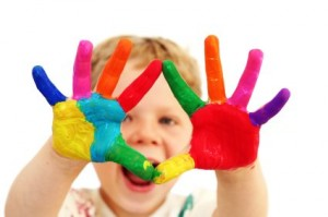 Happy child with painted hands
