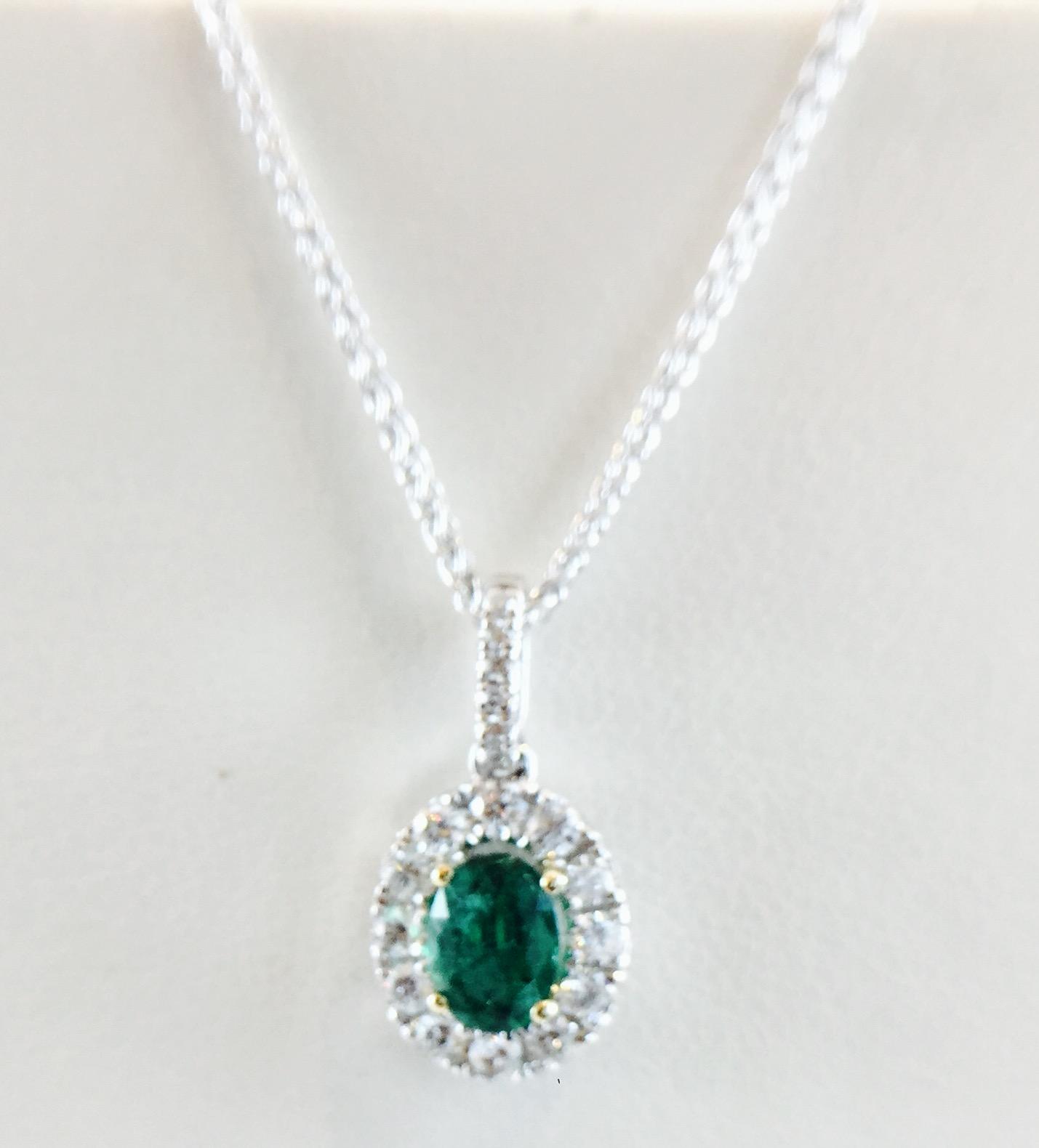 Bennion Jewelers - Diamond Halo and Emerald