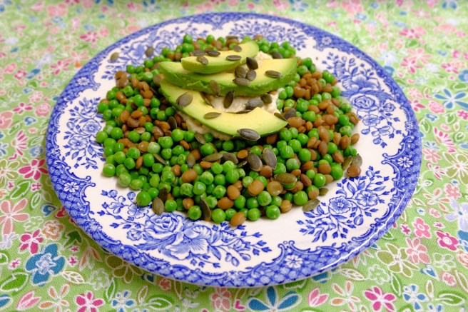 green lentil and pea salad with hummus, avocado and pumpkin seeds