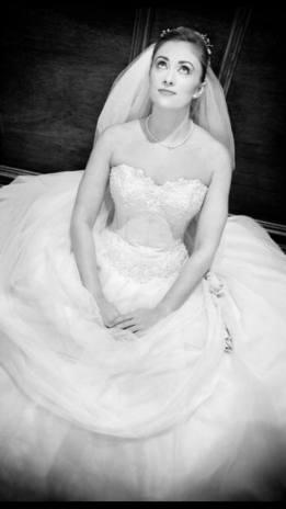 Model wearing white wedding dress