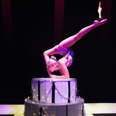 Contortionist Circus Act performing on tiered platform
