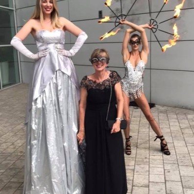 Charity event entertainers stilts and fire performer