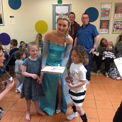 Princess Elsa entertaining children at Princess Party