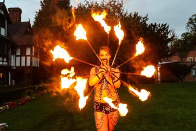 Fire performer with ring of fire