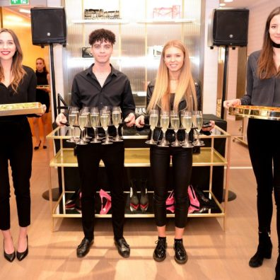 hospitality staff serving champagne at event