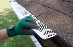 Installing Gutter Guards at Residential Property