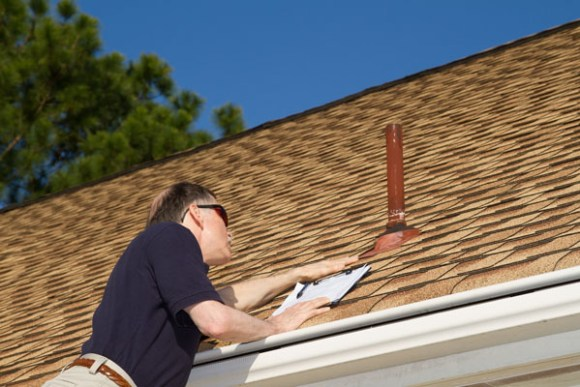 Oakland roofing contractor performing roof inspection