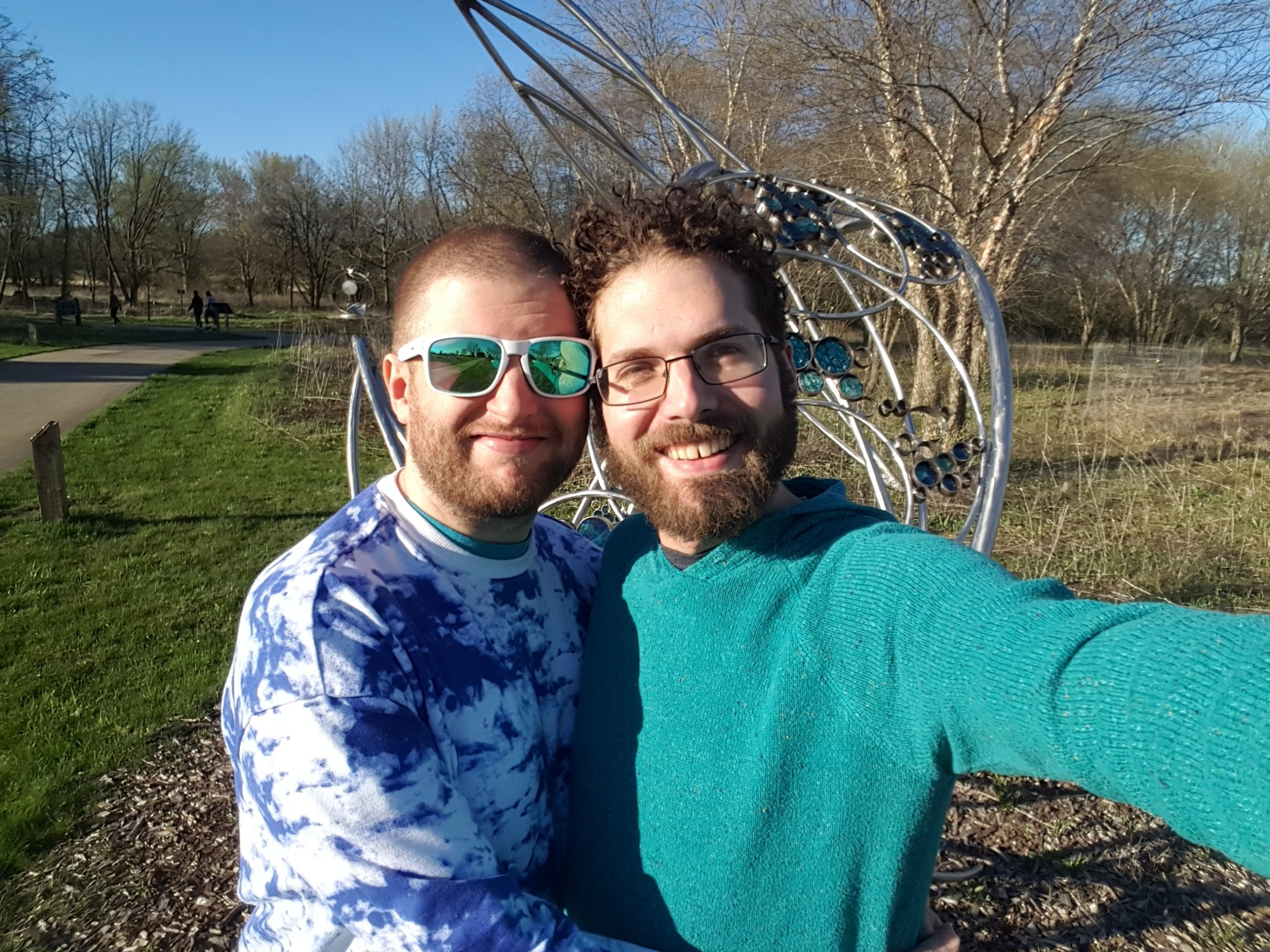 Selfie with my boyfriend John and myself in a sunny park.