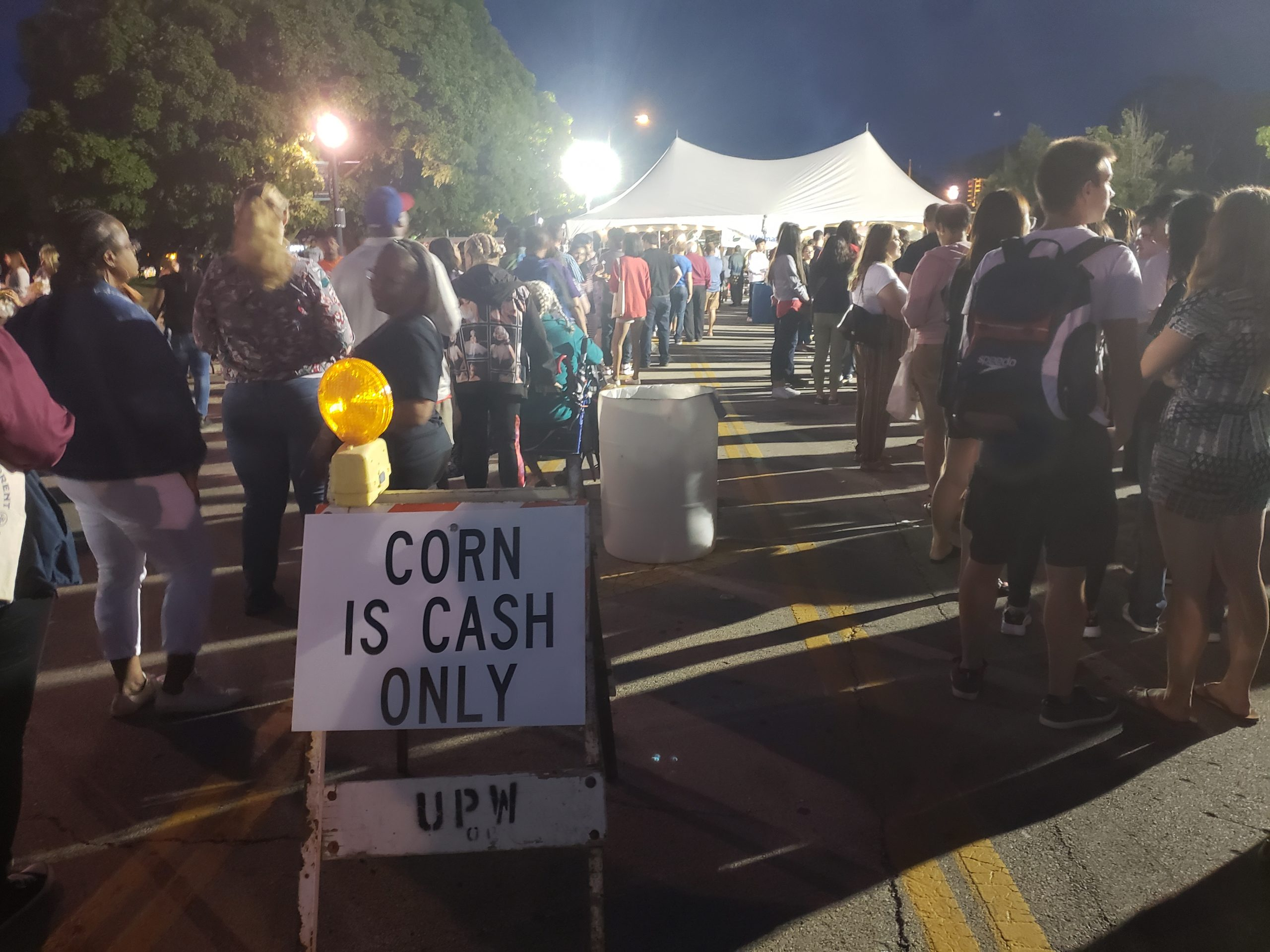 "The sweet corn festival. The sign says ""Corn is Cash Only"""